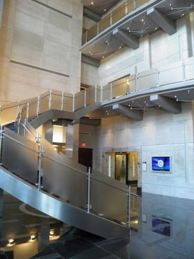 View of steel stairs curvature in lobby