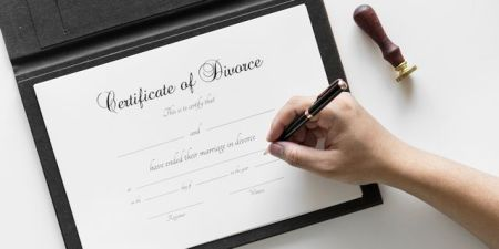Paperwork for uncontested divorce being signed by Montgomery client